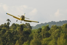 Photo of a Fuji FA-200 on approach in Kampala Uganda. The aircraft registration is 5X-MTN